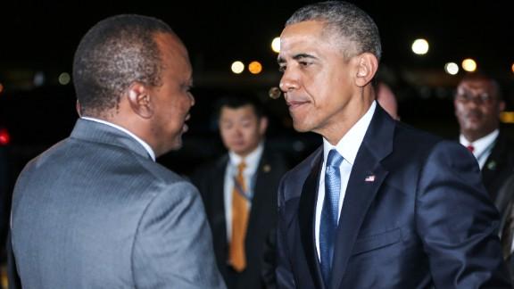 Obama greets Kenyatta on July 24.