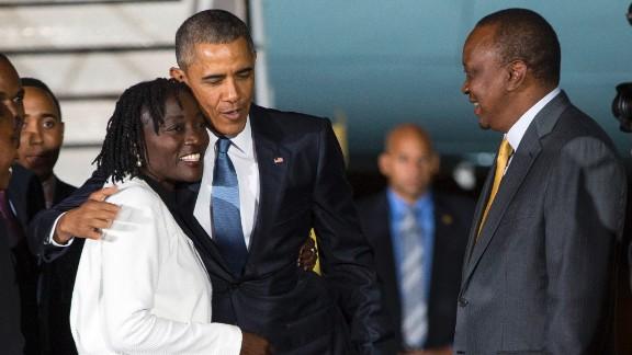 Kenyatta watches as Obama hugs his half-sister Auma on July 24.