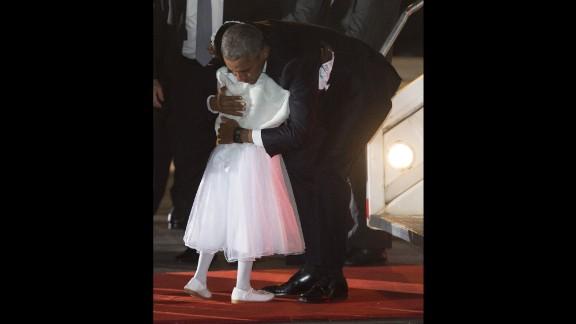 Obama hugs Joan Wamaitha, 8, upon his arrival in Kenya on July 24.