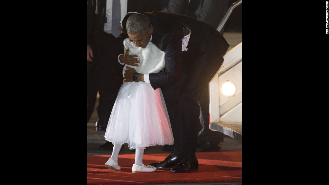 Obama hugs Joan Wamaitha, 8, upon his arrival in Kenya on July 24.