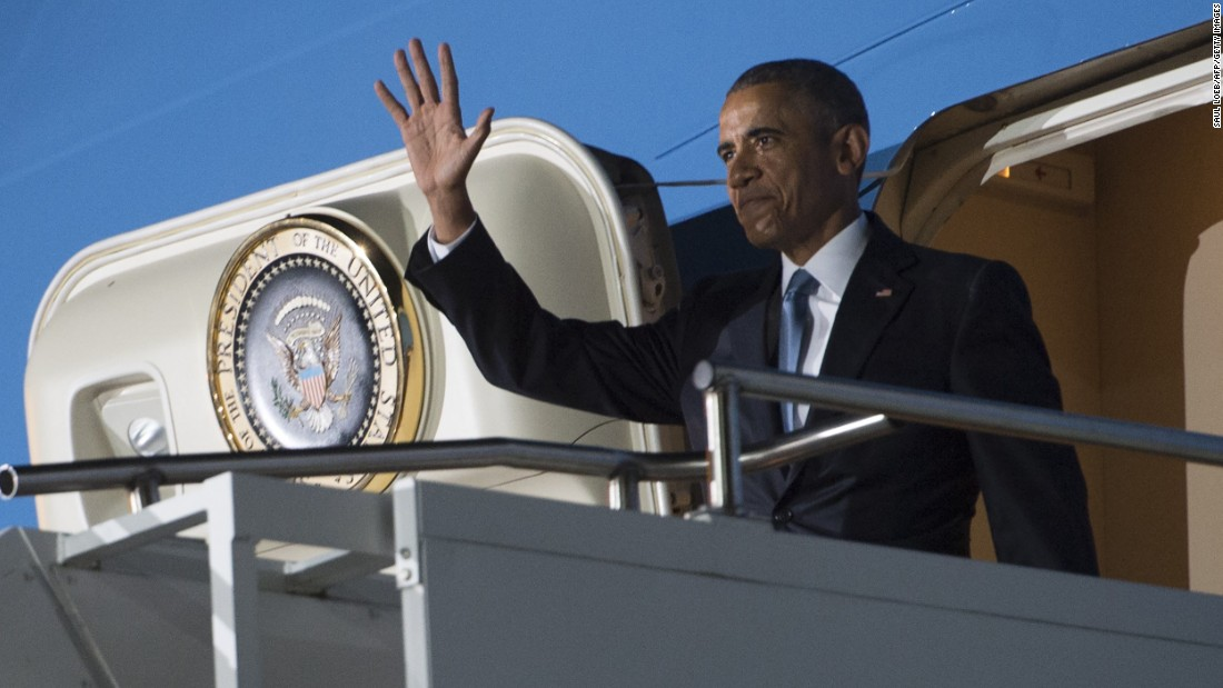 Obama waves from the door of Air Force One after arriving in Kenya on July 24.