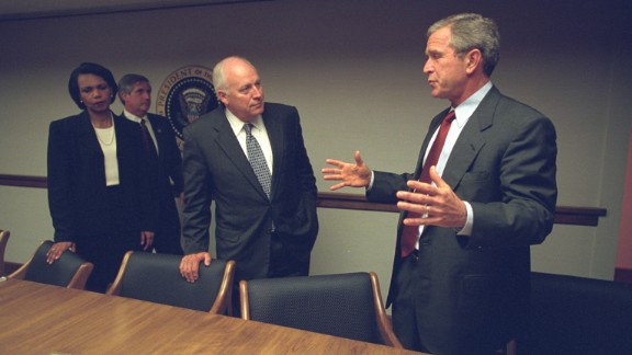 The photos capture the grim scenario facing the White House as commandeered airliners crashed into the World Trade Center, the Pentagon and a field in Pennsylvania. President George W. Bush, Cheney and staff gather at the President's Emergency Operations Center later in the day.