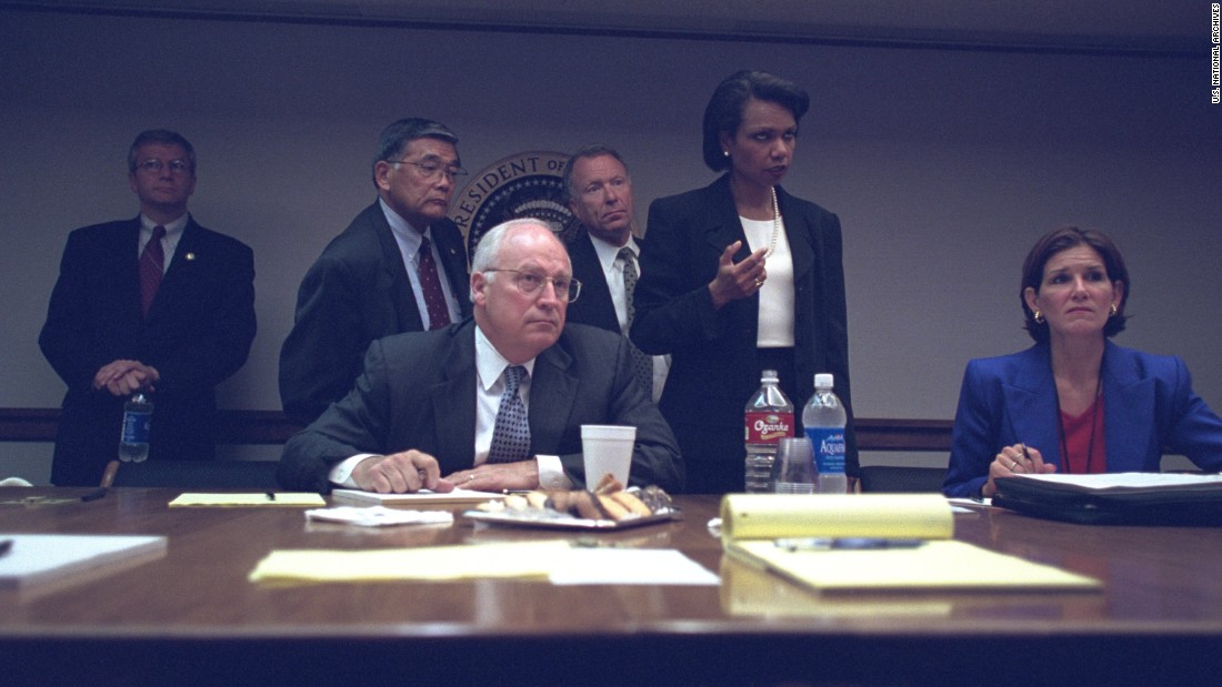 "Cheney with members of the White House staff, including National Security Adviser Condoleezza Rice. ""Frontline"" said Friday's release of photos was the second set requested by Hanna. That first set shows other behind-the-scenes photos of Bush and Cheney."
