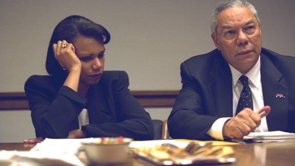 Rice and Secretary of State Colin Powell confer during the crisis.