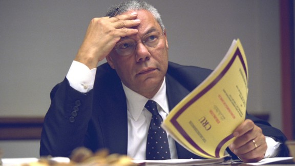 Secretary of State Colin Powell looks over a report. All of the released photos are available in a National Archives Flickr album.