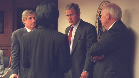 President Bush speaks with Vice President Cheney and members of his senior staff. The vice president had a few words with the president just before the latter's address to the nation. CIA Director George Tenet watched from the bunker, waiting for Bush to convene a late-night meeting of the National Security Council.