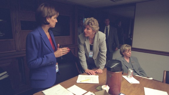 Mary Matalin talks with Karen Hughes, counselor to the President, near Lynne Cheney in the President's Emergency Operations Center.