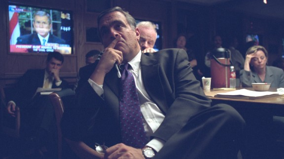 "CIA Director George Tenet listens to President Bush's televised address. The President said, ""Terrorist attacks can shake the foundations of our biggest buildings, but they cannot touch the foundation of America. These acts shatter steel, but they cannot dent the steel of American resolve."""