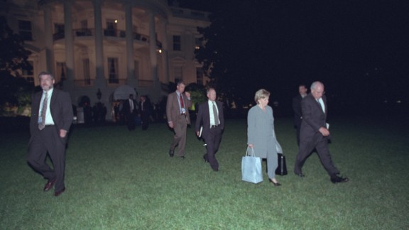"""The Cheneys depart the White House and prepare to board Marine Two. He later took a nighttime ride past the heavily damaged Pentagon. """"I recall watching the vice president, who was staring out the window at the Pentagon, and wondering what he may be thinking about, the responsibilities he would have in the future. A pretty sobering moment,"""" said Libby, his chief of staff."""
