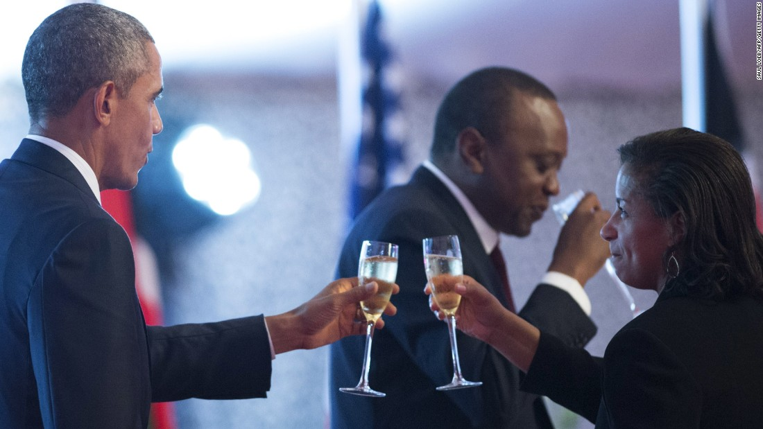 Obama and national security adviser Susan Rice share a toast during a state dinner in Nairobi on Saturday, July 25.