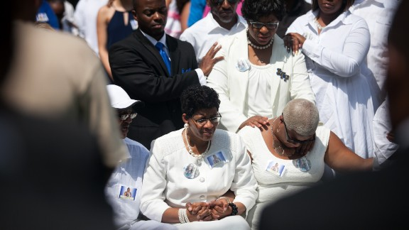 The mother of Sandra Bland, Geneva Reed-Veal, center, and sister Shavon Bland mourn at the gravesite during the funeral at Mount Glenwood Memory Gardens West cemetery, on Saturday, July 25, in Willow Springs, Illinois. Bland was arrested on July 10 for allegedly assaulting an officer during a routine traffic stop. On July 13, she was found dead in her jail cell. Police say the 28-year-old hanged herself with a plastic bag. Her family disputes that.
