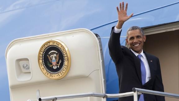 Obama boards Air Force One as he prepares to depart Jomo Kenyatta International Airport in Nairobi, Kenya, on Sunday, July 26.