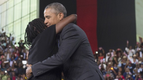 Obama embraces his sister Auma during an event at the Moi International Sports center in Nairobi on July 26.