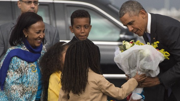 Obama receives flowers Sunday, July 26, upon his arrival at Bole International Airport in Addis Ababa.