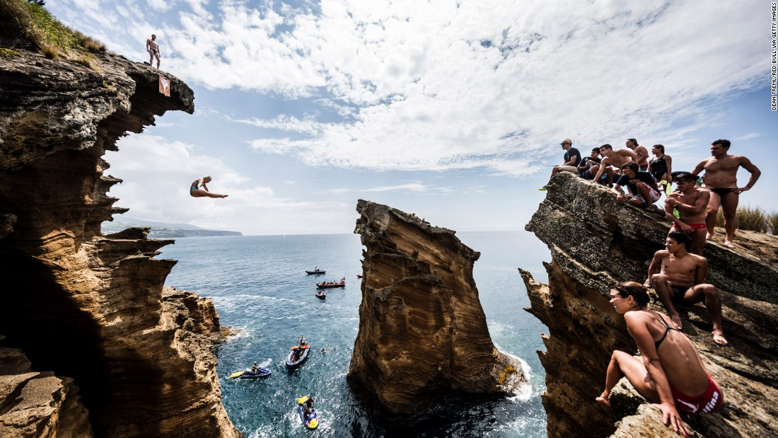 USA's Rachelle Simpson dives from a 20-meter cliff during an open training day of the fifth stop of the Red Bull Cliff Diving World Series, Vila Franca do Campo, Azores, Portugal, on July 15, 2015.