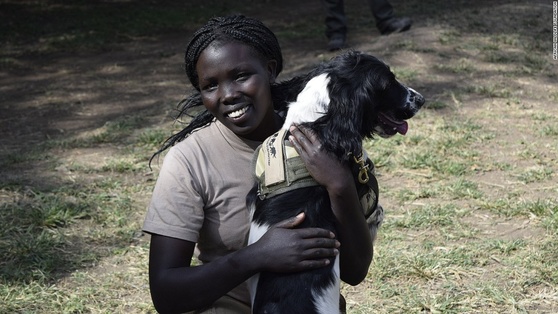 Kenya Wildlife Service ranger Erica Cheruiyot enjoys a playful moment with Asja. Erica and Asja will both be deployed to Mombasa, Kenya, where they will work both the seaport and airport.
