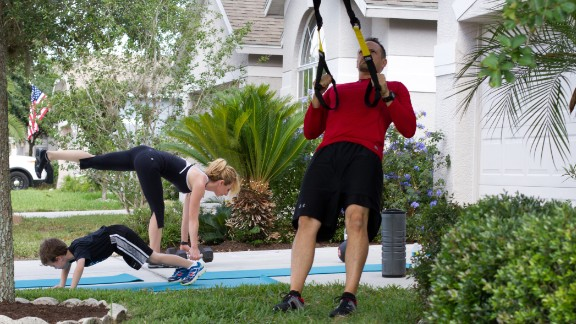While standing, hold TRX handles with a neutral grip. Lean your body straight back so that your arms extend at chest height. Make a rowing motion by bending your elbows and pulling your chest toward the handles. Keep your body aligned and core strong throughout the motion. Don