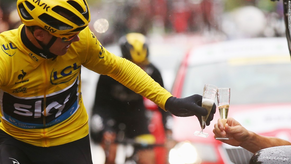 "Chris Froome toasts his Tour de France win on Sunday, July 26. See that and other amazing sports photos in this week's <a href=""http://www.cnn.com/2015/07/28/sport/gallery/what-a-shot-sports-0728/index.html"" target=""_blank"">""What a Shot!""</a>"
