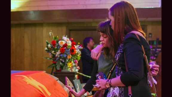 Sara Crochet and Natalie Hartzell, both friends and employees of Jillian Johnson, embrace each other while reflecting at Johnson's casket at Delhomme Funeral Home on July 27,  in Lafayette.