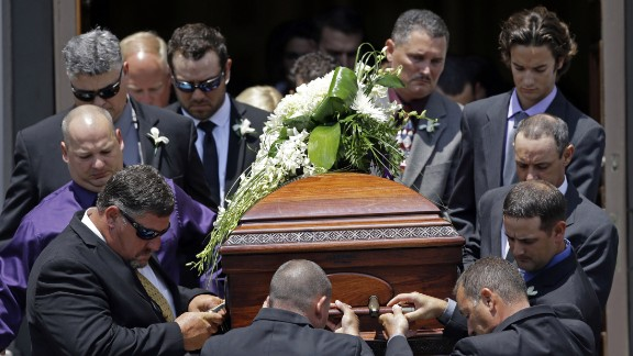 The casket of Mayci Breaux is carried out of the church after her funeral.