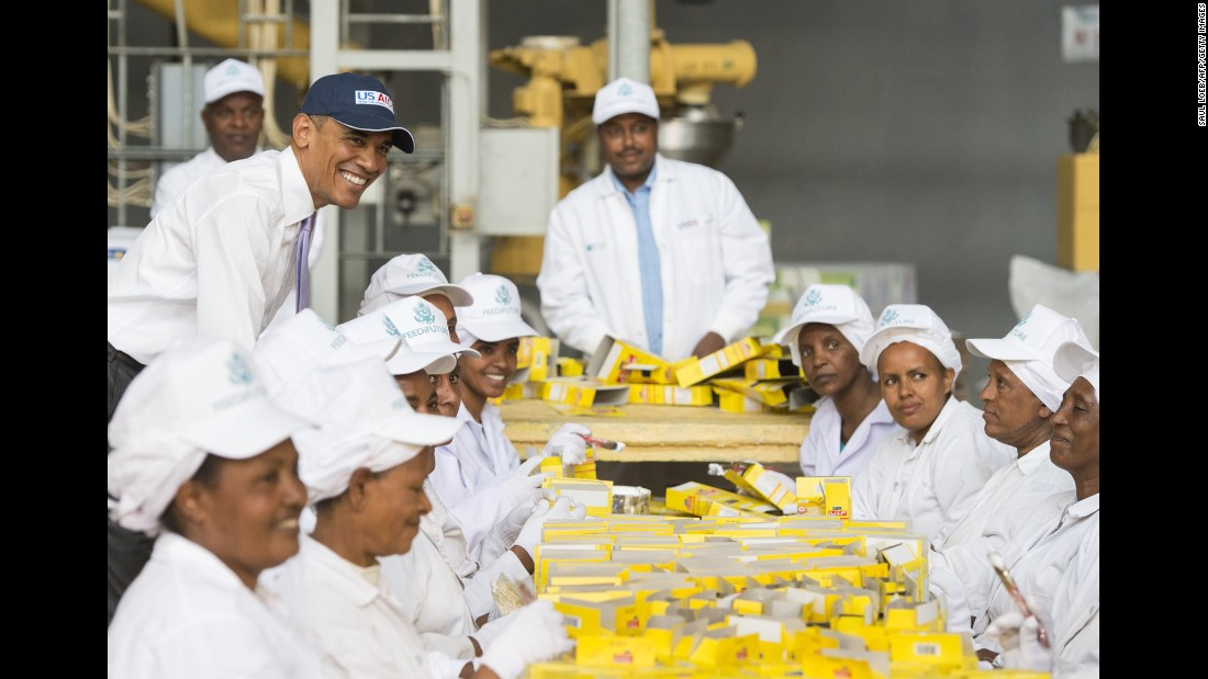 Obama stands alongside workers at Faffa Food as they pack boxes of food products in Addis Ababa on July 28. Faffa Food produces low-cost and high-protein foods.