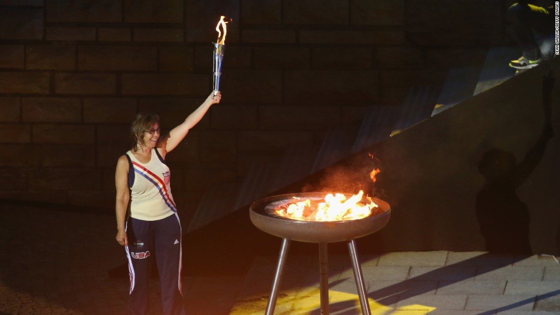 Nancy Glickman lights the flame at the European Maccabi Games in Berlin. She is the youngest daughter of Marty Glickman, one of two Jewish-American athletes denied the chance to run at the 1936 Olympics in the German capital, along with Sam Stoller.
