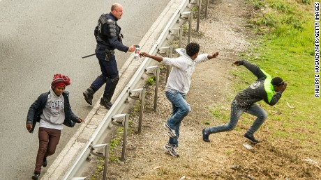 Police spray tear gas at migrants trying to access the Channel Tunnel in France.