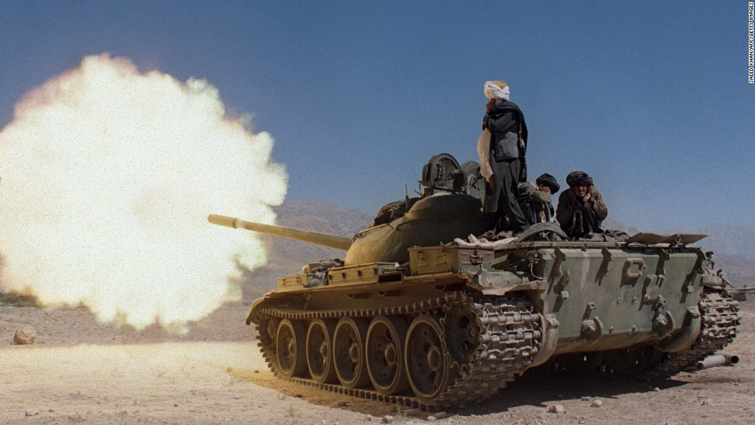 Taliban soldiers in Russian-made tanks fire on the forces of former Afghan defense minister Ahmad Shah Massood in October 1996.