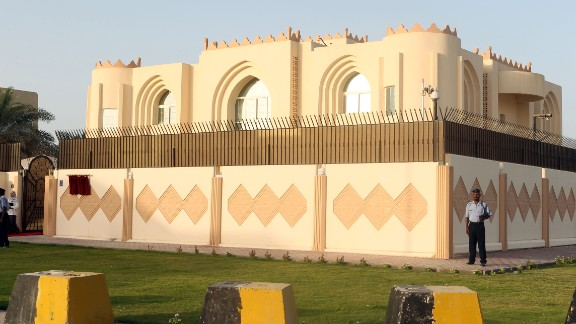 Security guards stand outside the new Taliban political office in Doha, Qatar, before its official opening in June 2013. The Taliban announced that they hoped to improve relations with other countries, head toward a peaceful solution to the Afghanistan occupation and establish an independent Islamic system in the country.
