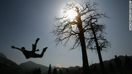 Warrior monks of Shaolin practice Kung Fu skills during a training session at the temple in 2005.