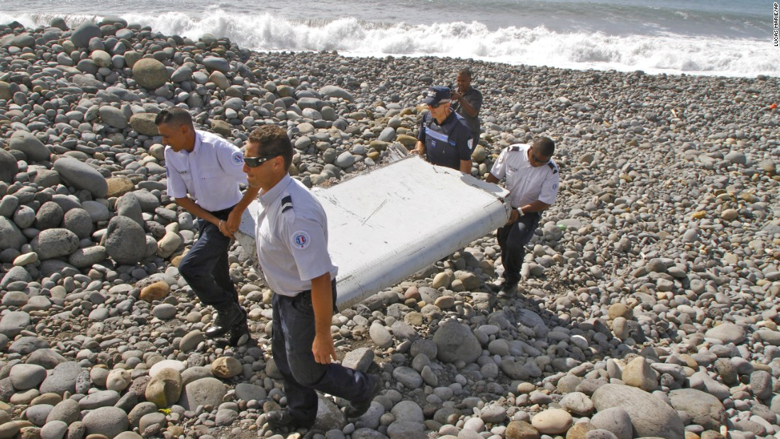 "French police officers carry a piece of plane debris <a href=""http://www.cnn.com/2015/07/30/world/gallery/debris-found-reunion-island/index.html"" target=""_blank"">that was found on Reunion,</a> a remote island in the Indian Ocean, on Wednesday, July 29. An international team of aviation experts <a href=""http://www.cnn.com/2015/07/30/world/mh370-debris-investigation/index.html"" target=""_blank"">is trying to determine</a> whether the airplane part came from <a href=""http://www.cnn.com/2014/03/07/asia/gallery/malaysia-airliner/index.html"" target=""_blank"">Malaysia Airlines Flight 370</a>, which disappeared in March 2014 with 239 people on board."