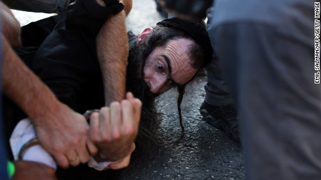 Yishai Shlissel in handcuffs in the aftermath of the knife attack in Jerusalem last July.