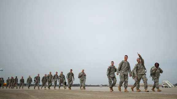 Soldiers from the U.S. Army's 101st Airborne Division walk across the tarmac at Campbell Army Airfield before reuniting with their families at a homecoming ceremony March 21, 2015 in Fort Campbell, Kentucky. The 162 soldiers were deployed in Liberia, where they helped fight the spread of Ebola.