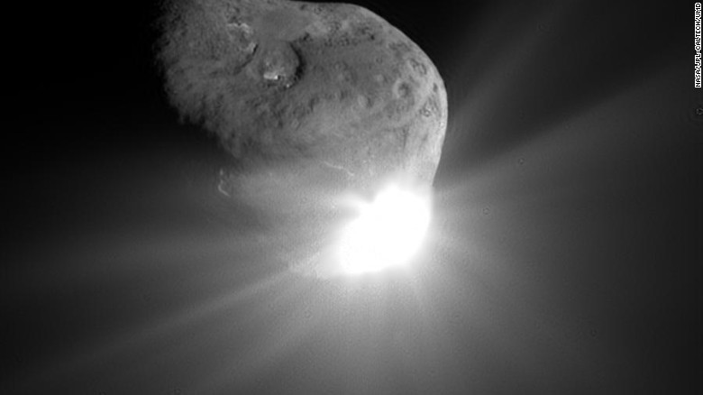 """NASA's <a href=""""http://www.nasa.gov/mission_pages/deepimpact/main/"""" target=""""_blank"""">Deep Impact spacecraft</a> was launched on January 12, 2005, and it traveled 268 million miles (431 million kilometers) to hurl its coffee table-sized probe into comet Tempel 1 on July 4, 2005. This image of Tempel 1 was taken by Deep Impact's camera 67 seconds after the probe hit the comet. Scattered light from the collision saturated the camera's detector and caused the bright splash seen in this image. The Deep Impact mission was supposed to end a few weeks later, but NASA approved an extension and renamed the spacecraft <a href=""""http://www.nasa.gov/mission_pages/epoxi/index.html"""" target=""""_blank"""">EPOXI</a>  and sent it on to<a href=""""http://www.nasa.gov/mission_pages/epoxi/epoxi20101104b.html"""" target=""""_blank""""> fly by Comet Hartley 2</a> in November 2010. The probe <a href=""""http://epoxi.umd.edu/"""" target=""""_blank"""">stopped communicating</a> with mission managers in September 2013 and was declared lost."""