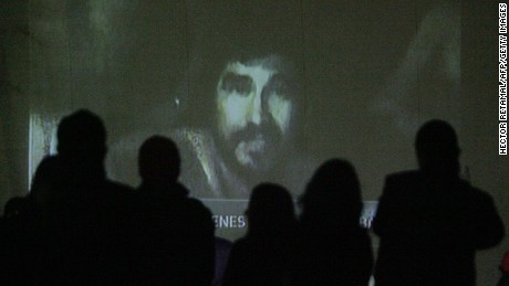 Relatives watch a video of the trapped miners recorded with a camera in a probe on August 26. Chilean television aired footage of the miners, showing them in good spirits and explaining how their underground shelter was set up.
