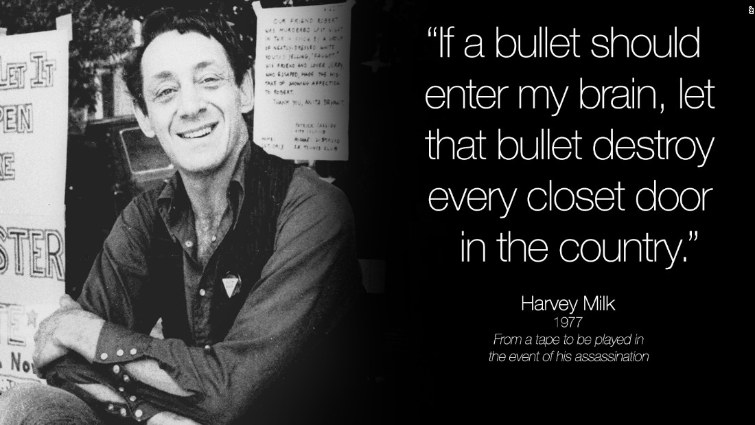Harvey Milk poses in front of his camera shop in San Francisco in this November 9, 1977.