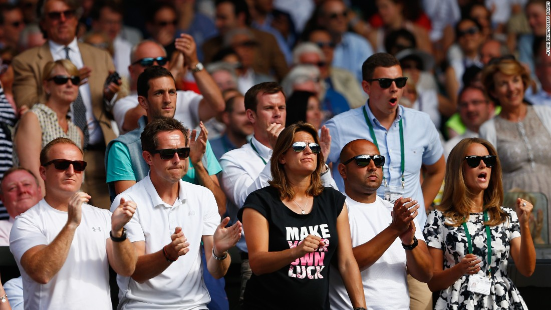 When tennis coach Amelie Mauresmo (C) was hired by Andy Murray in 2014, she became the only female to coach a top pro on the men's tour.  She is seen in the Wimbledon player's box alongside Murray's wife Kim Murray during the semifinal match against Roger Federer in July.