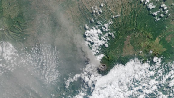 Ash and volcanic gases rise from the Mt. Raung volcano
