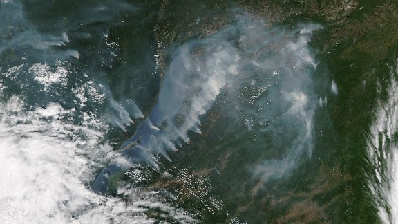 Smoke from fires near the shoreline of Russia