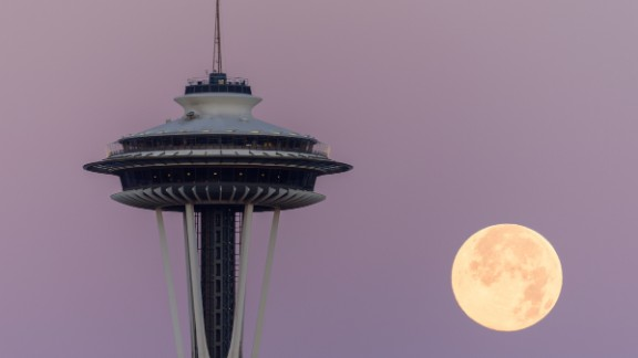 """Photographer Tim Durkan captured the bright blue moon in Seattle on Friday, July 31, 2015. """"It was spectacular to watch,"""" he said. Click through to see more photos from around the world."""