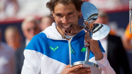 Rafael Nadal cuts a typical pose after claiming the Hamburg title with a straights sets win over Fabio Fognini.