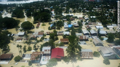 An aerial view shows floodwaters inundating houses and vegetation in Kalay, upper Myanmar's Sagaing region, on August 2, 2015.