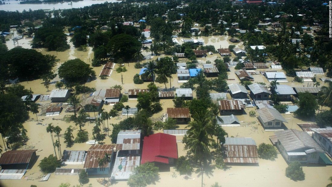 Floodwaters inundate a neighborhood in Kalay, in upper Myanmar's Sagaing region, on Sunday, August 2. Heavy rains in Myanmar have devastated several townships and have forced more than 18,000 people into shelters, officials said Saturday.