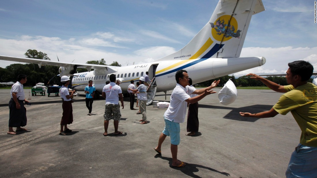 Volunteers unload relief items at Kalay airport.