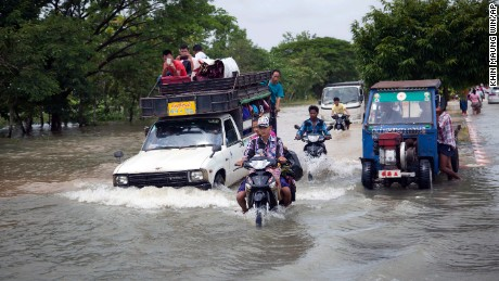 Vehicles make their way through a flooded road in Bago, 80 kilometers (50 miles) northeast of Yangon, Myanmar, Saturday, Aug 1.