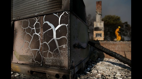 Heat marks are visible on an air-conditioning unit at a destroyed home in Lower Lake on August 1.