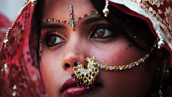 An Indian bride adorned in gold jewelry for her big day