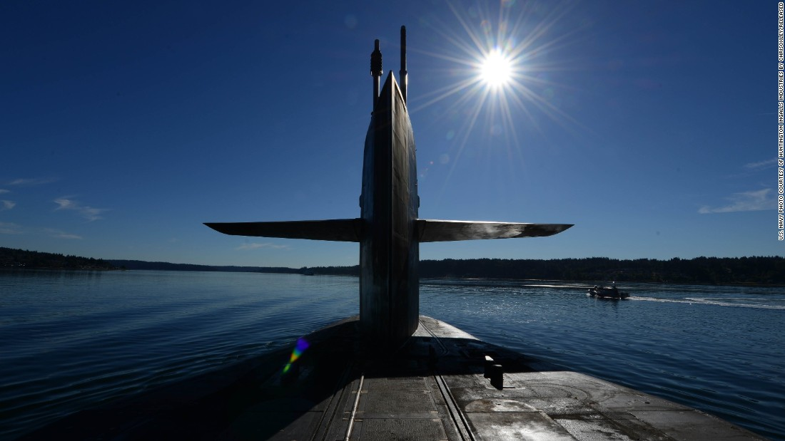 The Ohio-class guided-missile submarine USS Ohio transits Puget Sound, Washington, in June 2015. The Ohio and three other guided-missile subs -- USS Florida, USS Michigan and USS Georgia -- were originally built and deployed as ballistic-missile subs, but were converted to guided-missile platforms beginning in 2002 after the Navy concluded it had a surplus of the boomers.