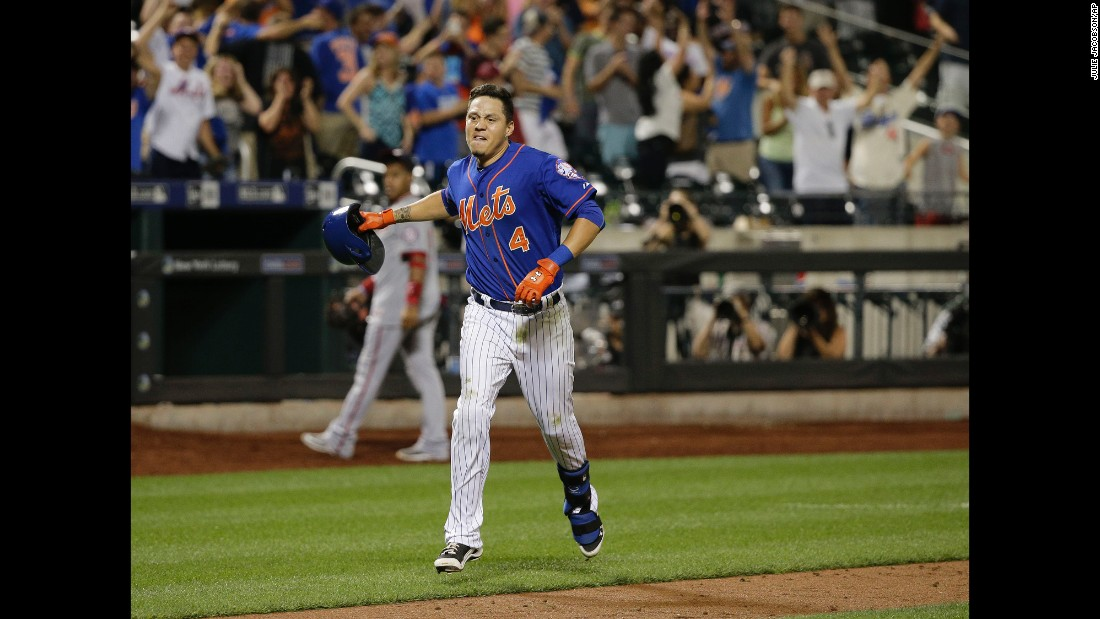 "Wilmer Flores tosses his helmet aside after hitting a walk-off home run for the New York Mets on Friday, July 31. <a href=""http://www.cnn.com/2015/08/01/us/wilmer-flores-mets-crying-home-run/index.html"" target=""_blank"">The dramatic game-winner</a> came two days after Flores cried during a game when he thought he had been traded by the Mets."