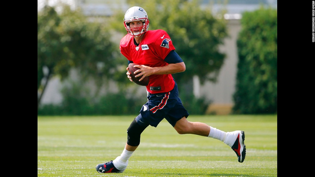 "New England Patriots quarterback Tom Brady takes part in training camp Thursday, July 30, in Foxborough, Massachusetts. Last year's Super Bowl MVP <a href=""http://www.cnn.com/2015/07/28/us/tom-brady-deflategate-suspension-upheld/"" target=""_blank"">is suspended for the first four weeks of the season</a> because of his role in the football-tampering scandal known as ""Deflategate,"" the league announced. Brady has said he did nothing wrong."